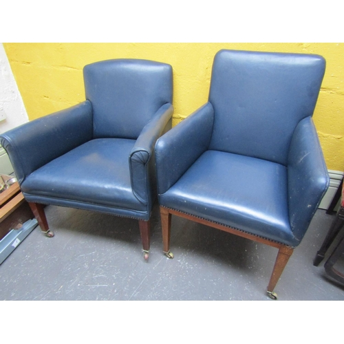 Two Dark Blue Leather Upholstered Edwardian Armchairs Mahogany Frames Brass Casters