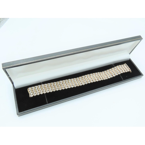 Five Row Ladies Diamond Line Bracelet of Attractive Form Total Diamond Weight Approximately 3 Carats. Bracelet Length 18.7cm, Width 1.7cm