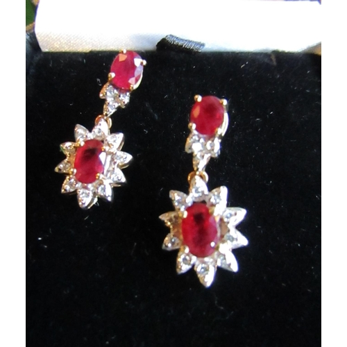 51 - Pair of Diamond Set Oval Cut Twin Ruby Drop Cluster Earrings of Attractive Colour Stones of Deep Hue...