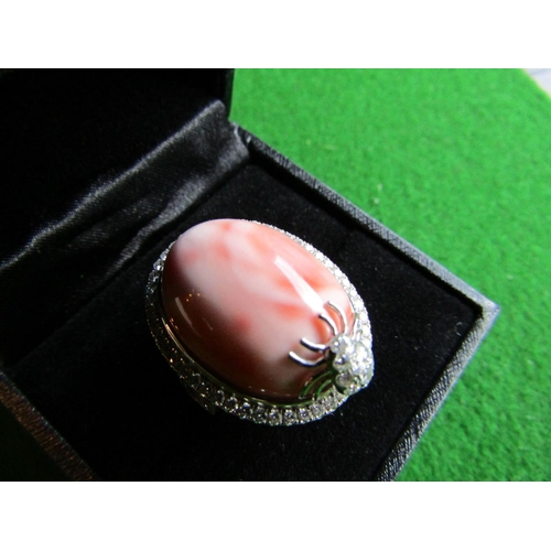 54 - Coral Mounted Cabochon Cut Ladies Ring Mounted on 18 Carat White Gold Band with Spider Motif Side De...