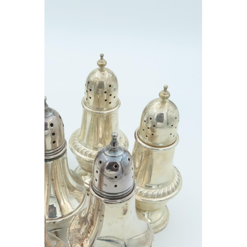 Pair of Solid Silver Salts Shaped Form with Gadrooned Waist Decoration above Turned Pedestal Bases