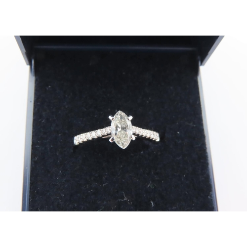 283 - Diamond Solitaire Marquis Cut Ladies Ring Mounted on 18 Carat White Gold Band with Further Diamond D...