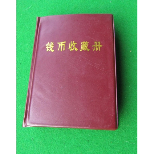 700 - Cased Wallet of Approximately 60 Chinese Coins Each Presented within Encapsulated Cases
