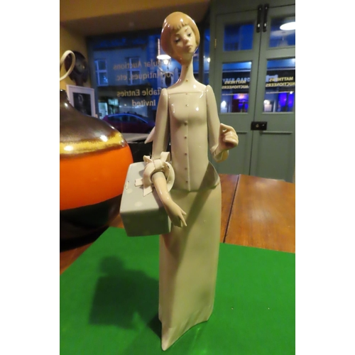 Lladro Fine Porcelain Figure of Lady with Parcel Approximately 11 Inches High Good Original Condition