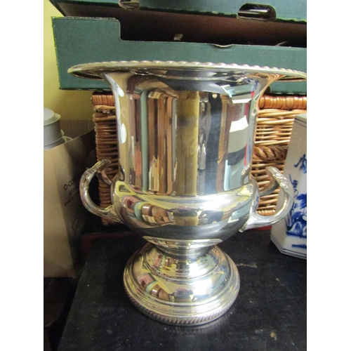 26 - Silver Plated Champagne Bucket Twin Handled Above Pedestal Base Approximately 12 Inches High...