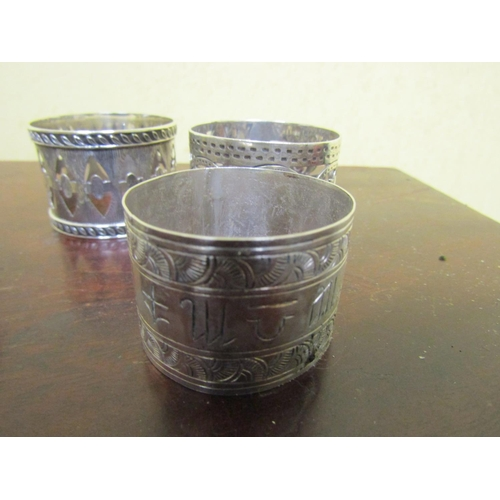 28 - Various Napkin Rings including Silver Examples...