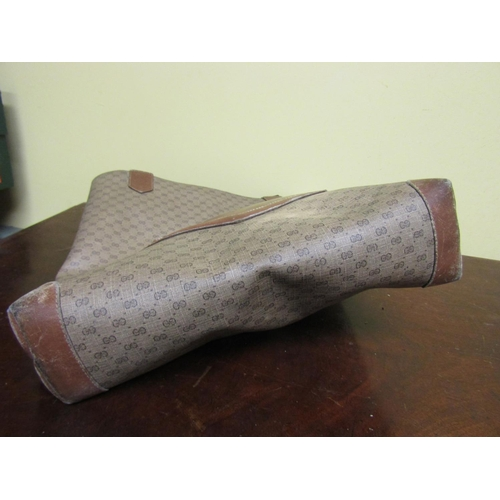 35 - Gucci Travel Bag Approximately 16 Inches High x 12 Inches Wide...