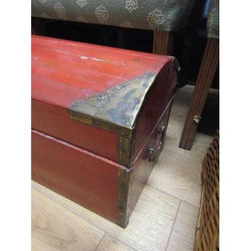 37 - Oriental Red Ground Dome Top Wooden Trunk with Brass Mounts Approximately 48 Inches Wide