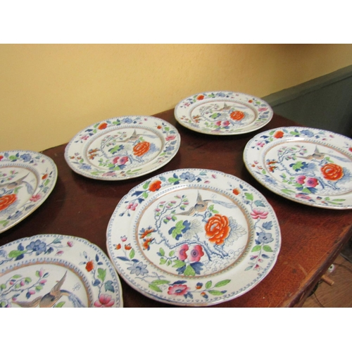 39 - Seven Antique Chargers Depicting Birds and Floral Motifs Each Approximately 10 Inches Diameter