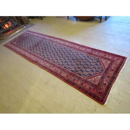 41 - Persian Pure Wool Runner Burgundy and Navy Ground Repeated Pattern Decoration Approximately 10ft 4 I...