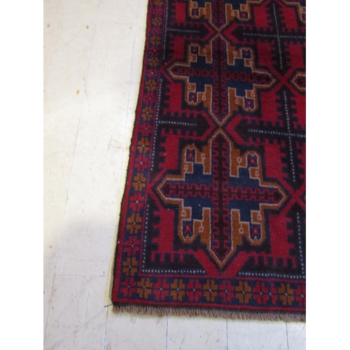 43 - Burgundy Ground Persian Pure Wool Rug Approximately 6ft 6 Inches Long x 3ft 8 Inches Wide...