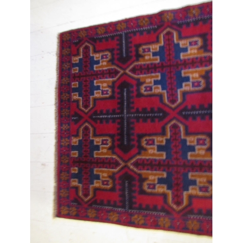 43 - Burgundy Ground Persian Pure Wool Rug Approximately 6ft 6 Inches Long x 3ft 8 Inches Wide