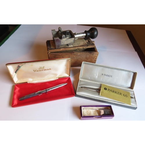 Parker Pen, Waterman Pen and Date Stamp along with Silver Plate Set Marker Four Items in Lot
