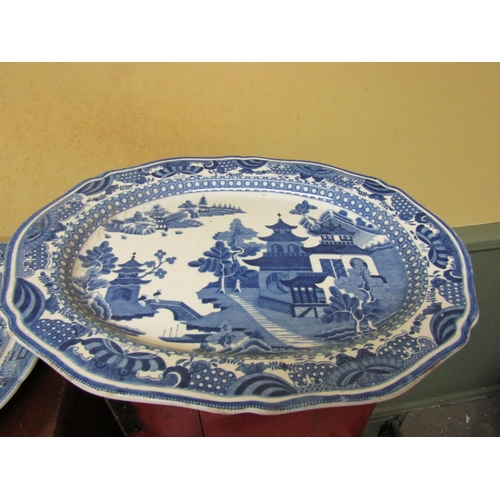 60 - Two Antique Blue and White Willow Pattern Platters Largest Approximately 19 Inches Wide Good Conditi...