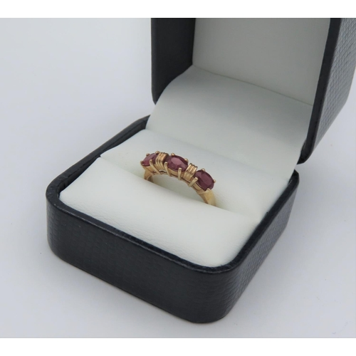 4 - 9 Carat Yellow Gold Ring Set with Three Oval Cut Rubies Approximately 1.4 Carats Ring Size N...