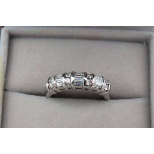 6 - Diamond Set Ladies Band Ring Further Set with Alternate Sections of Round Brilliant Cut and Baguette...