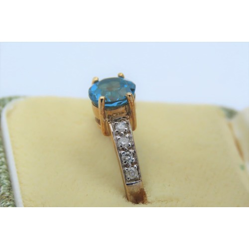 8 - 9 Carat Yellow Ladies Ring Set with Single Round Swiss Blue Topaz Centre Stone and Four Round Cut Di...
