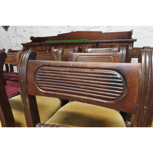 59 - Set of Sixteen Mahogany Dining Chairs Sabre Leg Supports Upholstered Seats Set includes Two Carvers ...