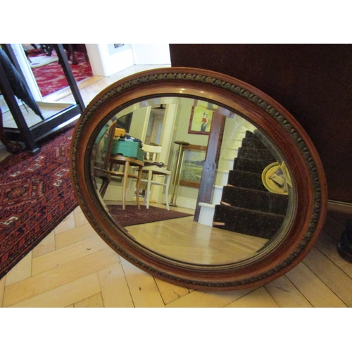 7 - Edwardian Walnut Oval Form Mirror Bevelled Plate Approximately 22 Inches Wide...