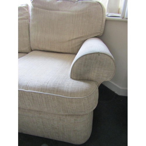 11 - Upholstered Settee Two Seater Modern Cream Fabric Upholstery Approximately 5ft Wide