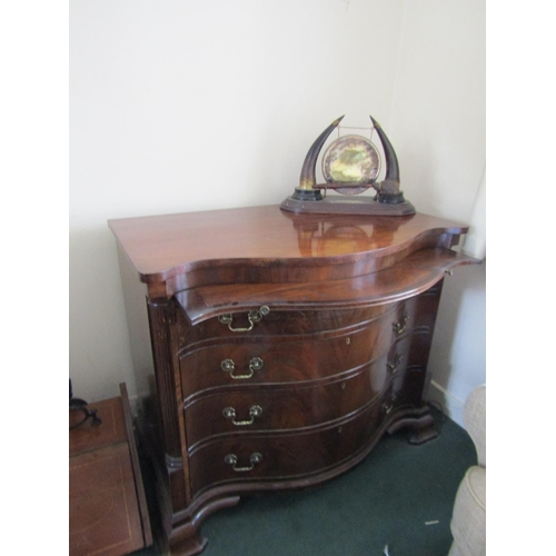 2 - Antique Figured Mahogany Serpentine Front Chest with Brushing Slide over Four Drawers Shaped Bracket...