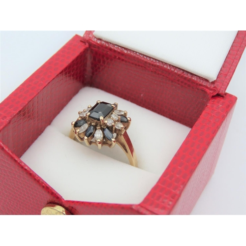 27 - Sapphire and Diamond Ladies Cluster Ring Mounted on 9 Carat Gold Band Ring Size R
