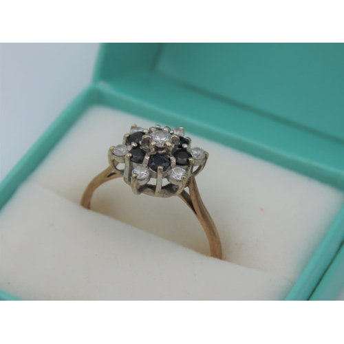 31 - Sapphire and Diamond Ladies Cluster Ring Mounted on 9 Carat Yellow Gold Band Ring Size U
