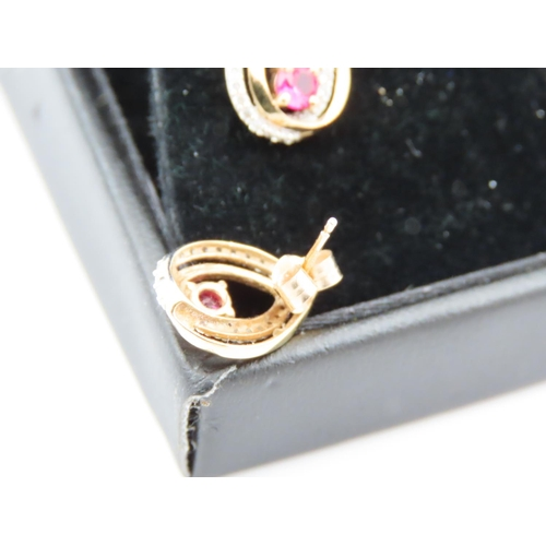 44 - Pair of Ruby and Diamond Set Ladies Earrings Mounted on 9 Carat Yellow Gold