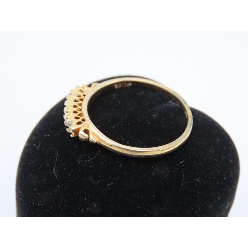 8 - Seven Diamond Ladies Line Ring Mounted on 18 Carat Yellow Gold Ring Size R and a Half