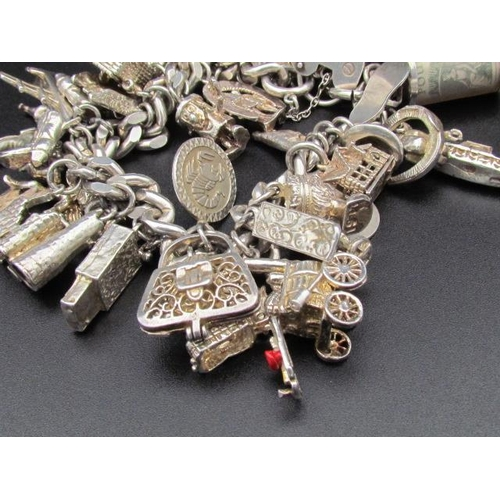 520 - Solid Silver Charm Bracelet with Approximately Thirty Plus Charms Some Very Rare Good Weight of Silv...