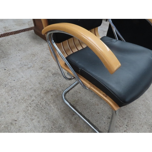 32 - Leather Upholstered Armchair Chrome Plated Supports