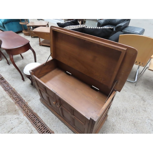 52 - Ercol Twin Door Side Cabinet or Mule Chest with Panelled Doors Lift Up Top Approximately 4ft 6 Inche...