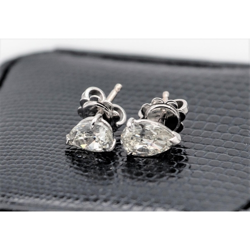 4 - Pair of 18 Carat White Gold Set Pear Cut Diamond Earrings Each of 1 Carat Weight Set in Three Claw S...