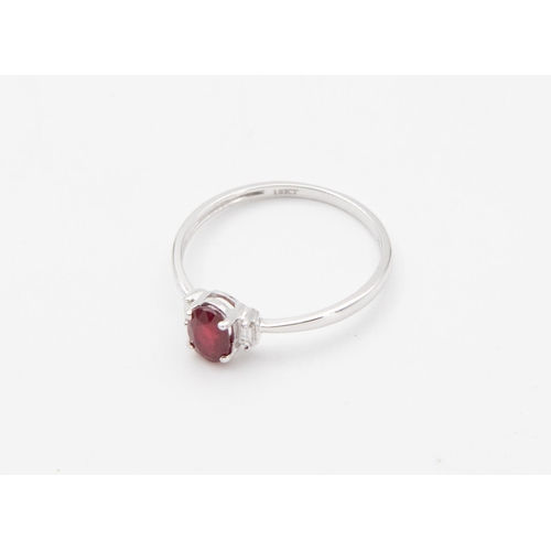 40 - White Gold Three Stone Ruby and Diamond Ladies Ring Oval Mixed Cut Ruby with Baguette Cut Diamond to...
