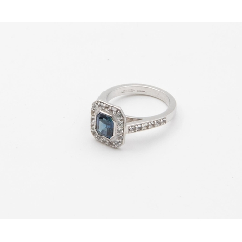 44 - 18 Carat White Sapphire and Blue Sapphire Halo Cluster Ladies Ring Central Emerald Cut Sapphire Rub ...