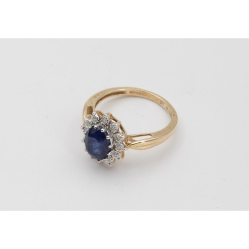 48 - Sapphire and Diamond Ladies Cluster Ring Mounted on 9 Carat Gold Oval Mixed Cut Sapphire Claw Set to...