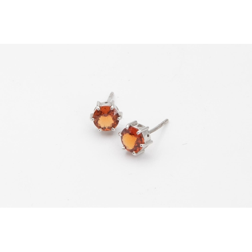 60 - Pair of 18 Carat White Gold Set Single Stone Hessonite Garnet Ladies Earrings Circular Mixed Cut Hes...