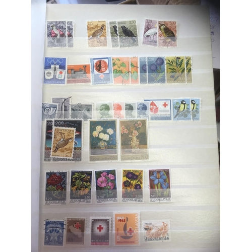 12 - STAMPS : Four stock books of various mint and used stamps Tanzania to Zimbabwe , great for thematics...