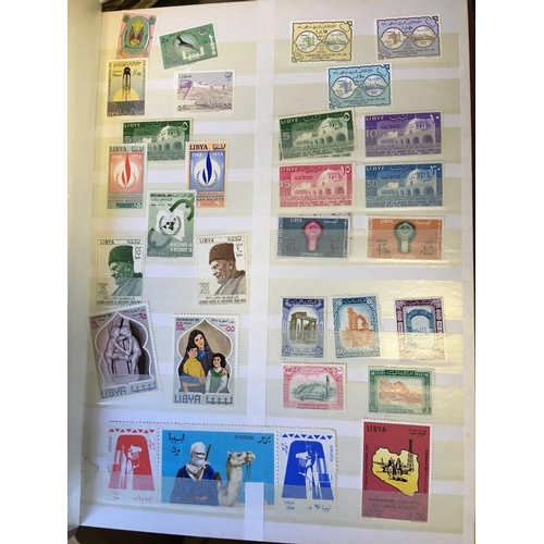 4 - STAMPS : Two stock books with World stamps, plus some covers including 1960's GB FDC's and a few auc...