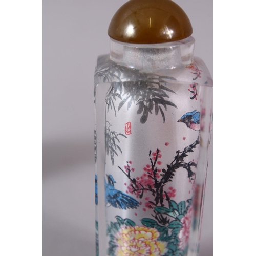 13 - TWO CHINESE REVERSE PAINTED SNUFF BOTTLES, One with floral scenes, the other with birds, 9cm & 5cm.