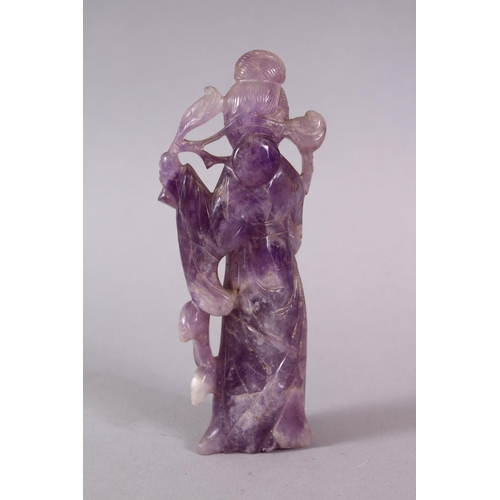 17 - A CHINESE CARVED AMETHYST FIGURE OF GUANYIN, stood holding a scepter and staff, 12.5cm