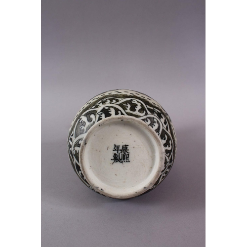 18 - A CHINESE PORCELAIN DRAGON VASE, the dragon amongst stylized clouds and waves, the base with a four ...
