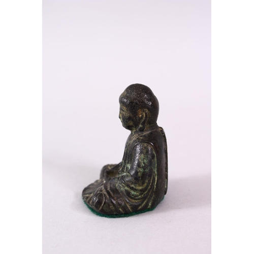 21 - A CHINESE BRONZE FIGURE OF SEATED BUDDHA, seated with hands and legs crossed, the verso with a raise...
