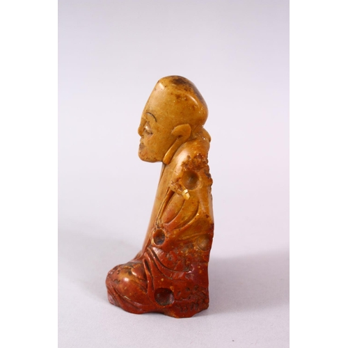 22 - A CHINESE CARVE3D SOAPSTONE FIGURE OF A JOLLY MAN, in seated position, 11cm