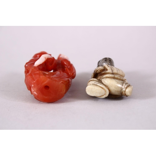 23 - TWO CHINESE CARVED HARDSTONE FIGURES, the red carved figure of guanyin and a boy, 7cm, the other soa...