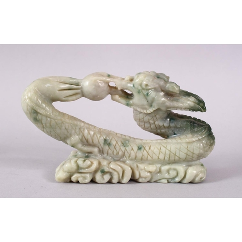 25 - A CHINESE CARVED SOAPSTONE FIGURE OF A DRAGON & PEARL, the dragon intertwined chasing the pearl amon...