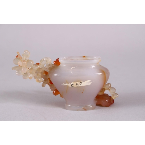 28 - A CHINESE CARVED AGATE PRUNUS VASE, with carved prunus decoration in relief, 11cm wide, no cover