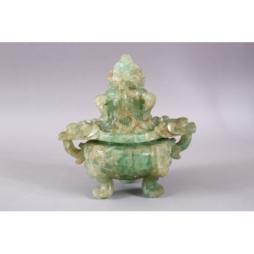 36 - A CHINESE CARVED GREEN QUARTZ TWIN HANDLE VASE AND COVER, with lion dog carved finial's,  upon tripo...