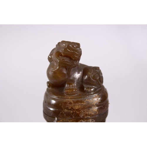 39 - A CHINESE CARVED JADE / JADE LIKE TWIN HANDLE VASE & COVER, with twin carved lion handles and rings,...