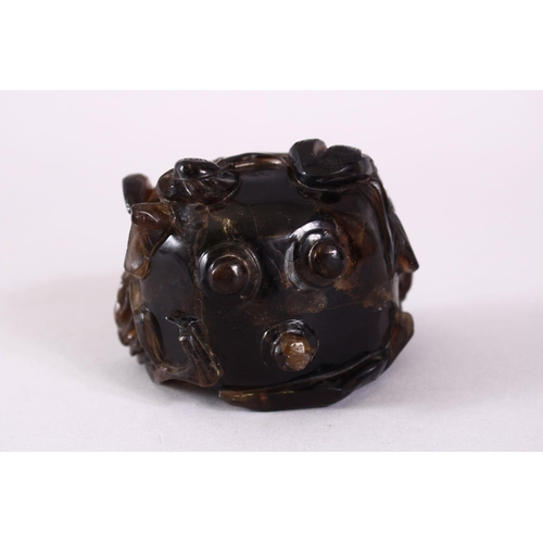 40 - A CHINESE CARVED DARK CRYSTAL / QUARTZ FLORAL POT & COVER, the body carved with flora and stood upon...